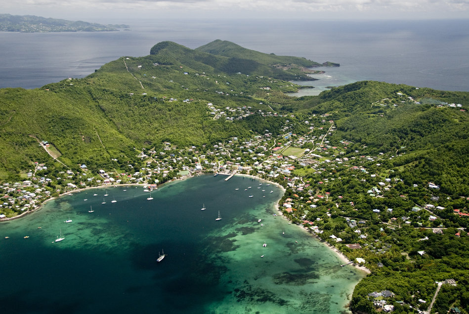 Aerial view of Bequia harbor (Port Elizabeth) with St. Vincent in background. Grenadines.