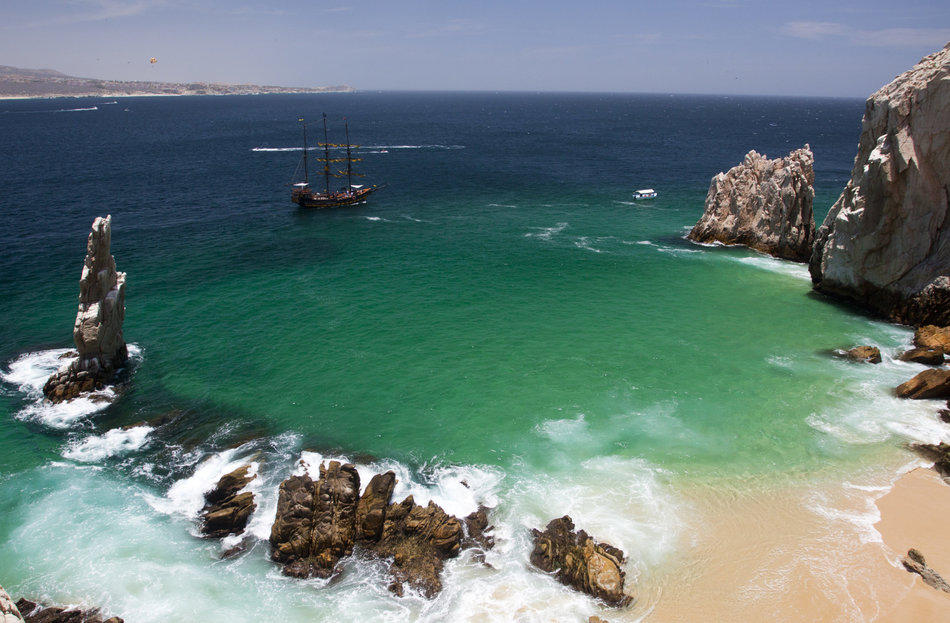 Tall ship moored off Lover's Beach and Los Arcos.